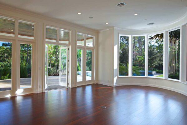F2-Family-Room-overlooking-Pool1-1600x1000-1